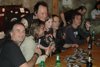 Band with young fan at merchandise booth